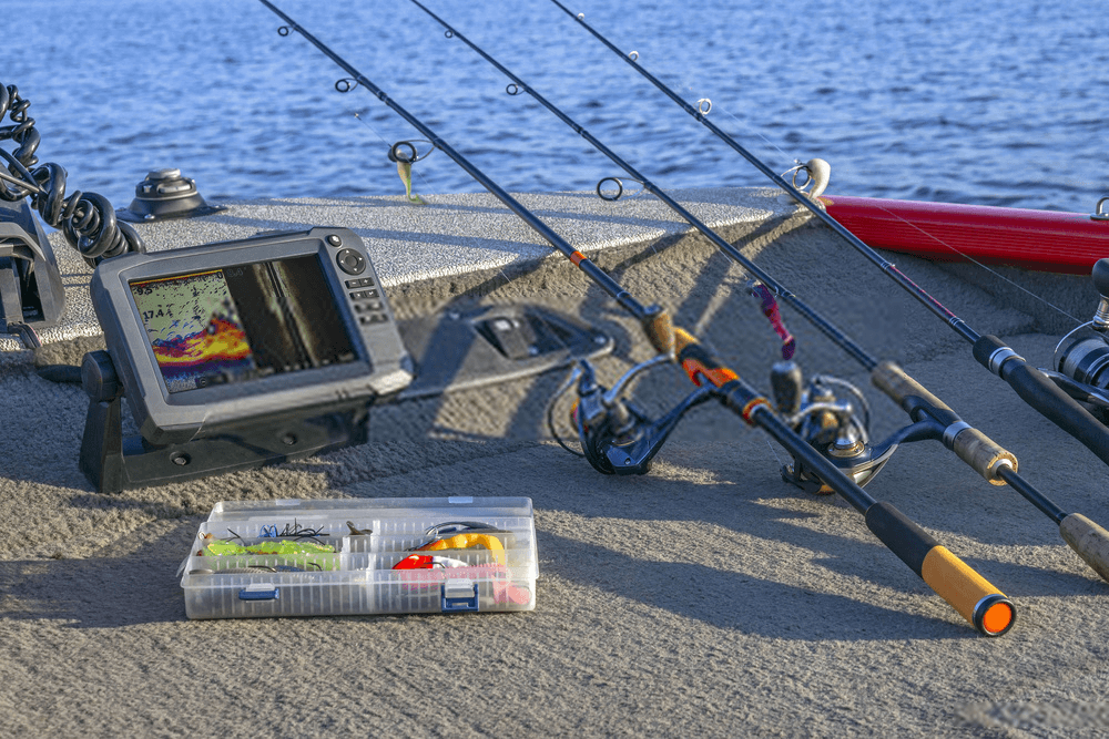 fishfinder with rod in a boat