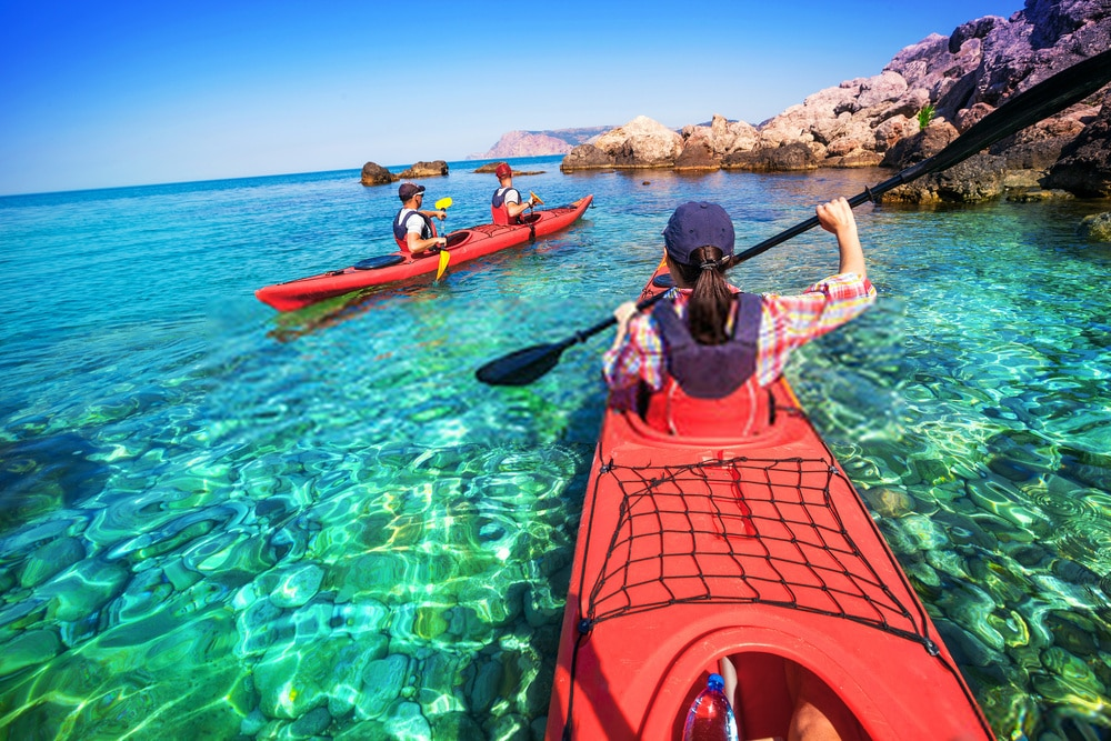 young girl kayaking with friend